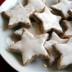 "Cinnamon Stars - These German ""Zimt Sterne"" are made with ground almonds instead of flour for a delicious gluten-free Christmas cookie. They're brushed with a shiny lemon glaze for a pretty finish."