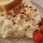 Awesome Egg Salad with a Kick - Egg salad kicked up with Dijon mustard, crumbled bacon and horseradish.  I use light mayo and sour cream to keep it healthy.  Serve on lightly toasted wheat rolls with lettuce and tomato.