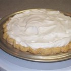 Pineapple Cream Pie - The lovely thick cream filling is cooked slowly on the stove to perfectly blend the egg yolk, sugar, cornstarch, vanilla, butter and crushed pineapple. Then it 's poured into a graham cracker crust and chilled. Just before serving, it 's topped with a sweetened whipped cream with just a touch of almond flavoring.