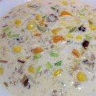 Calico Wild Rice Soup - Bell peppers are combined in chicken stock with wild rice in this corn starch thickened soup flavored with tarragon.