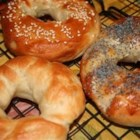 Bagels I - The dough for these plain white bagels can be prepared in the bread machine or kneaded by hand.  To cook, simmer them in boiling water and then bake in the oven.