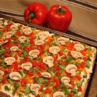 Cool Veggie Pizza - This appetizer is a cool pizza made with refrigerated crescent roll dough and topped with finely chopped vegetables. Zucchini, mushrooms, green peppers, green onions and tomatoes all work well as toppings.