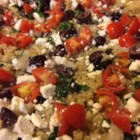 Greek Quinoa - Toss quinoa with Kalamata olives, feta cheese, tomatoes, and basil for a Greek quinoa salad ideally suited to potlucks, picnics, and barbeques.