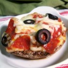 Personal Portobello Pizza - A delicious recipe that substitutes a portobello mushroom for a pizza crust. Try using pesto sauce instead of spaghetti sauce, and experiment with your favorite pizza toppings.