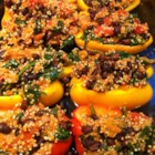 Stuffed Peppers with Quinoa - Stuffed red bell peppers made with quinoa, black beans, and spinach are a colorful, whole-grain side dish.