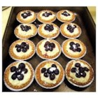 Mango Cheese Tart with Blueberries - This yummy tart was my mums recipe. A shortdough crust filled with mango cream cheese and piled high with blueberries. Serve chilled for a great summer dessert.