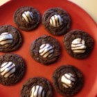 Brookies (Fudgy Brownie Cookies) - Brownie-style cookies, also known as brookies, are made with brownie mix and topped with a chocolate kiss for a crowd-pleasing treat.