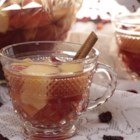 Cranberry Sangria - A spiced cranberry-apple wine punch makes a festive drink to toast the winter holidays. Chill the sangria for a day or so to blend the flavors.