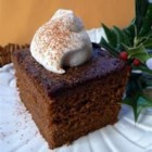 Favorite Old Fashioned Gingerbread - This soft and spicy cake is flavored with molasses, ginger, cinnamon, and cloves. Serve it with fresh whipped cream!
