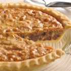 NESTLE(R) TOLL HOUSE(R) Chocolate Chip Pie - NESTLE(R) TOLL HOUSE(R) Chocolate Chip Pie features the sweet, creamy richness of a brown sugar base combined with chopped nuts and delicious chocolate morsels. Serve warm with whipped or ice cream.