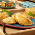 Black Bean & Beef Empanadas - Empanada dough is filled with a tasty combination of ground beef, onion, black bean soup and queso fresco and is baked until golden perfection. They're loaded with flavor and guaranteed to become a weeknight favorite.