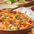 Chicken Chilaquiles from Campbell's Kitchen - This Mexican-inspired dish features a combination of shredded cooked chicken, tomato chipotle soup, onion, garlic, cheese and crispy tortilla strips. It's easy to prepare, super delicious and guaranteed to be a hit at your dinner table!