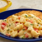 Creamy Poblano Mac & Cheese - Mac & cheese goes from ordinary to extraordinary with the addition of sautéed fresh vegetables and creamy poblano & queso soup. This crowd-pleasing casserole is incredibly good, easy to prepare and sure to earn rave reviews!