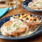 Pork Chops with Creamy Poblano Sauce - Jazz up ordinary pork chops by serving them with an easy, scrumptious sauce made with creamy poblano and queso soup and some milk. It adds fabulous flavor to perfectly seasoned chops. Plus, you can have this delicious meal on the table in just 25 minutes!
