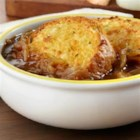 Speedy French Onion Soup - Warm up with a bowl of this savory soup that's loaded with incredible flavor. Caramelized onions simmer with sweet onion soup and beef consommé. It's topped with cheesy garlic Texas toast and is so good you may want to double the recipe because it will be gone in a flash!