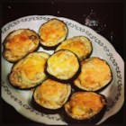 Eggplant Delight - Sliced Eggplant topped with sliced onion smothered with cheese. You can make these ahead of time, just reheat and top with cheese before serving.