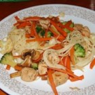 Stir Fried Pasta with Veggies - Broccoli, cauliflower and carrots are added to a savory stir fry of garlic, onion and chicken, with dashes of soy sauce to season the mix. Serve over hot spaghetti.
