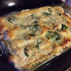 Chicken and Spinach Alfredo Lasagna - Savory shredded chicken layered with fresh spinach, creamy Alfredo sauce, melted mozzarella, ricotta, Parmesan cheese and lasagna noodles.
