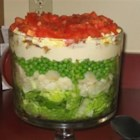 Layered Salad - This makes a whopping salad, but once you start eating it, you'll wish you'd made more. Lots of crunchy and delicious ingredients like water chestnuts, peas, chopped tomato, and crumbled bacon are topped with a homemade dressing.