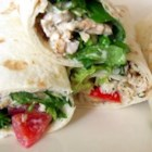 Warm Chicken Ranch Wraps - These sandwiches-on-the-go are a full meal deal: grilled or fried chicken, tomatoes, lettuce and rice pilaf in a creamy ranch dressing snugly wrapped in a warm tortilla.