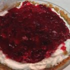 Cranberry Cream Pie II -  The crust is graham crackers studded with pecans. The filling is whipped cream and cream cheese with a splash of orange liqueur. And the topping is a sweetened fresh cranberry sauce. Chill and decorate with whole cranberries and a sprig of mint.