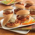 Baked Parmesan Meatball Sliders - A mini sandwich recipe with homemade meatballs in a fire-roasted tomato sauce topped with mozzarella cheese.