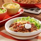 Beef Taco Quinoa Bowl - A quinoa bowl recipe with taco seasoned beef, tomatoes and cheese topping quinoa.