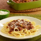 Chorizo Bolognese - A Latin-inspired Bolognese sauce recipe with ground beef, chorizo, sliced olives, adobo seasoning and tomato sauce served over pasta.