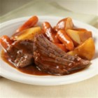 Easy Slow Cooker Pot Roast - Zesty onion soup mix combined with tomato sauce and prepared gravy makes an easy sauce for this slow-cooked pot roast.