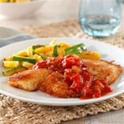 Hunt's(R) Crispy Breaded Tilapia - A delicious breaded tilapia recipe coated with a Parmesan cheese breading and topped with a chunky balsamic tomato sauce.