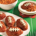 Hunt's(R) Touchdown Mini Meatloaf - Delicious oval-shaped meatloaves glazed with rich ketchup before baking and finished with string cheese to look like footballs.