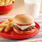Pepperoni Pizza Burgers - A burger recipe with chopped pepperoni, oregano and crushed red pepper mixed with the beef and topped with mozzarella cheese.