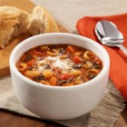 White Bean and Kale Minestrone Soup - Vegetarian minestrone soup recipe uses frozen chunky vegetables, canned white beans, and frozen chopped kale for ease of prep.