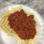 Spaghetti with Corned Beef - Ready-made spaghetti sauce is simmered with savory corned beef to make a thick, hearty topping for spaghetti cooked in bouillon.