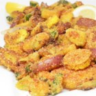 Arkansas Fried Veggie Skillet - Batter and fry up potatoes, onions, green tomatoes, and okra using this recipe for Arkansas fried veggies.