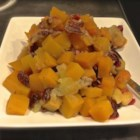 Savory Slow Cooker Squash and Apple Dish - A savory holiday side dish with butternut squash, apples, cranberries, and spices is made in a slow cooker to keep you out of the kitchen while everyone is getting their food ready.