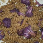 Purple Cauliflower Pasta - This colorful purple cauliflower is tossed with toasted walnuts, rotini pasta, and Parmesan cheese for a flavorful dinner treat.