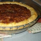 Real Pecan Pie - This very sweet and gooey pie is chock-full of pecan halves coated with dark corn syrup, lightly beaten eggs, sugar and a splash of vanilla. This divine filling is poured into a prepared crust, and baked in a slow oven until golden and set.