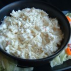 Paige's Feta Slaw - Coleslaw with an inviting new twist of feta cheese and green onions - sure to become a new favorite! One large head of green cabbage may be used in place of the packaged slaw.