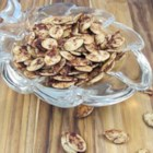 Roasted Cinnamon Spice Pumpkin Seeds - Season your pumpkin seeds with cinnamon, sugar, and ginger with this recipe that is a hit with the whole family!