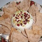 Christmas Dip - A rich, creamy cheese spread is layered with red cranberries and green pistachios, and turned out onto a dish for a festive and colorful holiday treat.