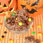 Slow Cooker Chocolate-Covered Nuts - Make chocolate covered peanut candy clusters with this recipe using a mixture of candies.