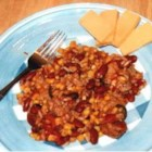 Mexican Pork Chops - Tender pork chops are cooked up Mexican-style with tomatoes, corn, beans, and rice.