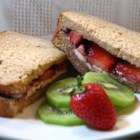 Berry Good Sandwich - This is a wonderful springtime treat for kids of all ages. A simple spread of Neufchatel cheese and strawberry jam and fresh chopped strawberries is the easy filling for this sandwich. Many variations are possible - blueberries and blueberry jam, apricots and apricot jam, etc...