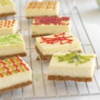 Honey Maid Holiday Cheesecake Presents - Cheesecake bars on a graham cracker crust are decorated to look like festive holiday gifts.