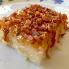 Biko - Glutinous white rice, also known as sticky rice or sweet rice, cooked with coconut milk and then baked with a coconut topping, is the Filipino dessert known as biko.