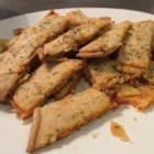 Pizza Fries - Pie crust is topped with marinara and mozzarella cheese, cut into strips, and baked into pizza fries creating a fun snack for the whole family.