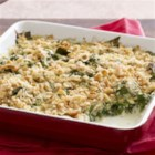 Saucy Spinach Bake - Need a fresh idea for spinach? This side dish combines spinach in a cheesy sauce with a topping of crushed crackers and shredded Mozza-Cheddar cheese.