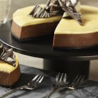 Tuxedo Cheesecake - Chocolate and vanilla come together as a perfect pairing in this gorgeous layered cheesecake - the perfect dessert for impressing a crowd.