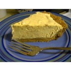 Peanut Butter Pie 2000 - Peanut butter is combined with whipped cream cheese and sugar, and then milk is poured in slowly and beaten until well blended. Whipped topping and chopped peanuts are folded in, and then this yummy filling is spooned into a graham cracker crust and frozen.